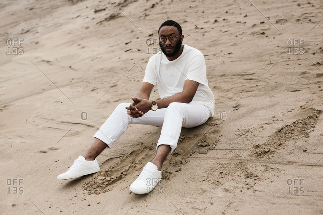 Man in white clothes on beach