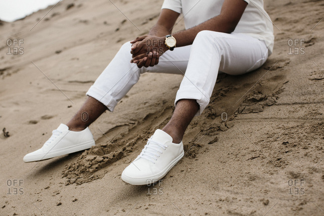 Man in all white clothes on beach