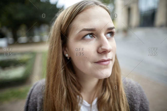 Portrait of a thoughtful young woman outdoors