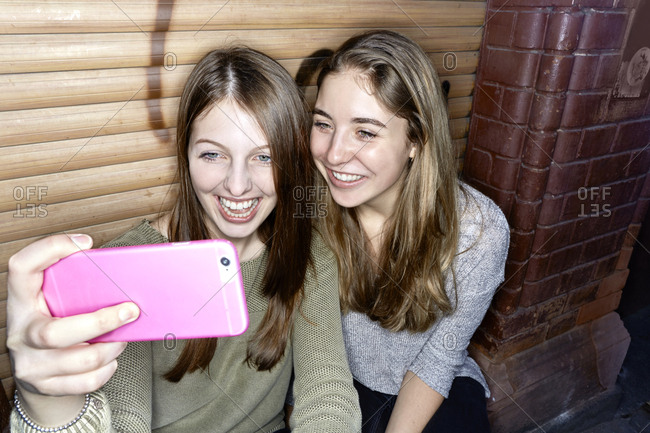 Two happy young women taking a selfie