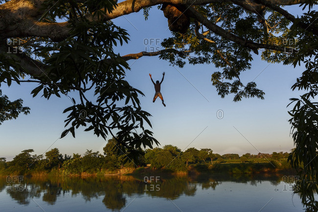 Boy jumping in to the Magdalena river in Mompox, Colombia