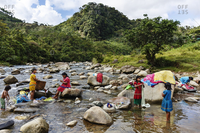 Choco Department - October 23, 2014: Embera women washing clothes in the river