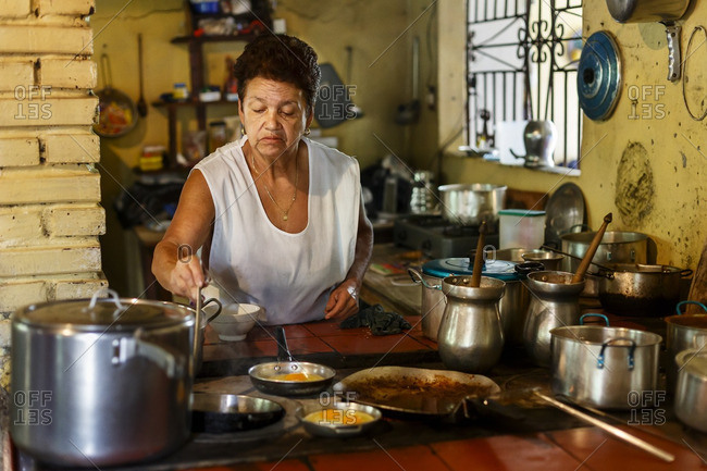 Albania, Colombia - December 19, 2012: Woman cooking in road restaurant