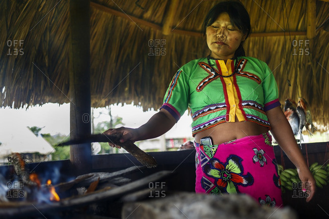 Mutata, Colombia - January 15, 2013: Indian woman cooking on firewood