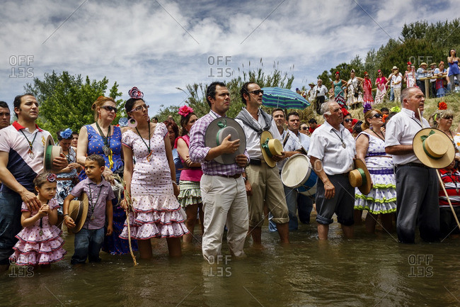 Andalucia, Spain - May 25, 2012: Families pray during the El Rocio pilgrimage