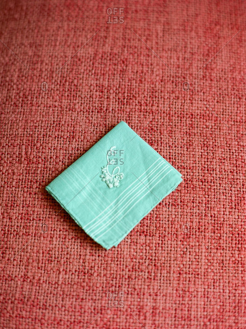 Light blue handkerchief with white embroidery