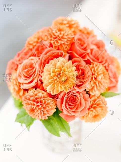 Bouquet of orange dahlias and roses