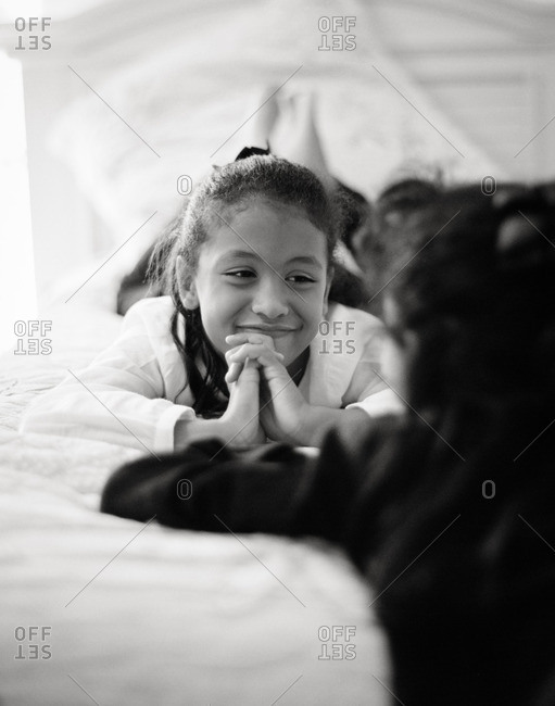 Girl smiling at her sister in black and white
