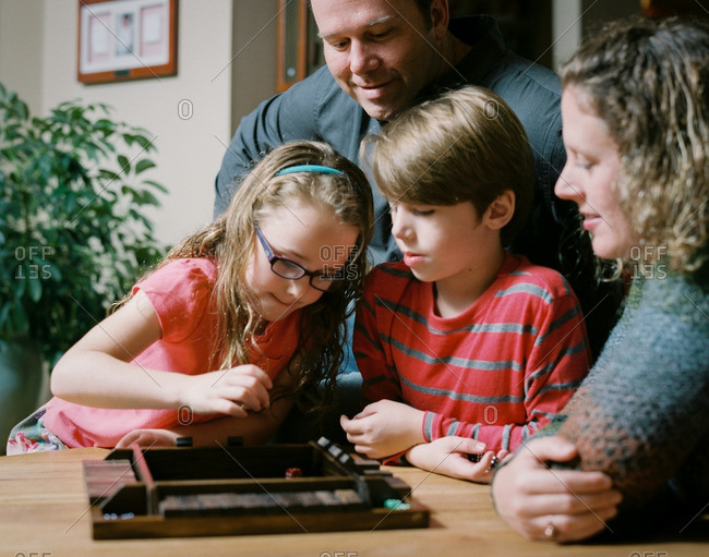 Family playing board games together