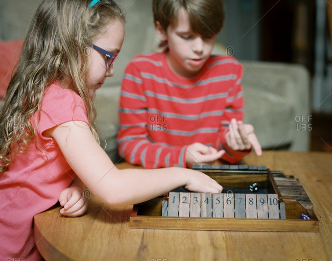 Siblings playing board games together