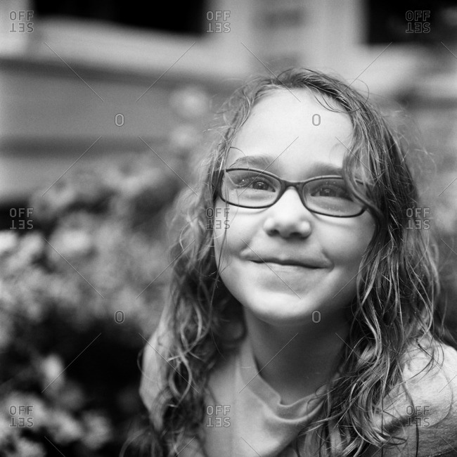 Portrait of a young girl with glasses in black and white