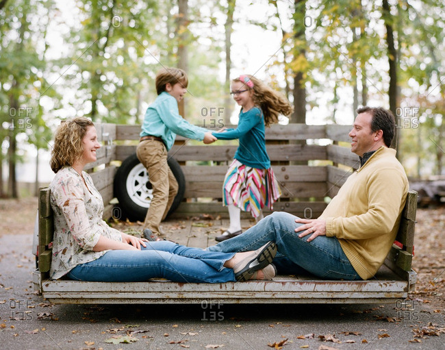 Children dancing on a trailer while parents sit in front