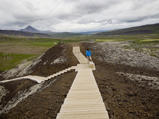 Man walking on wooden steps on a mountain