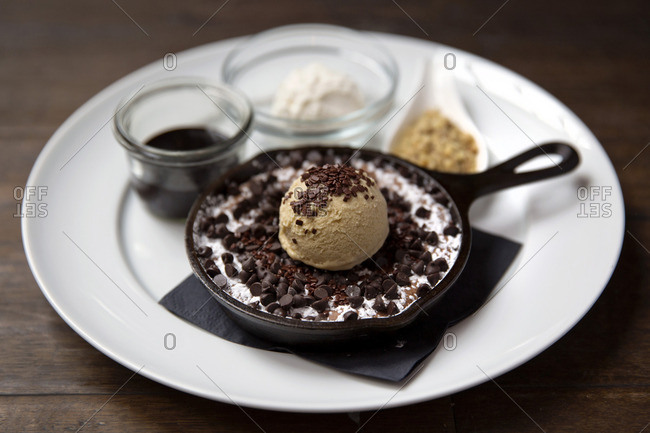 Dessert dish with chocolate chips and ice cream scoop