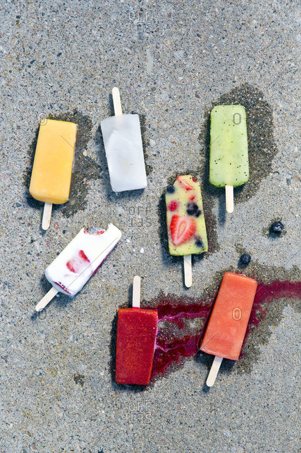 Popsicles melting on a sidewalk