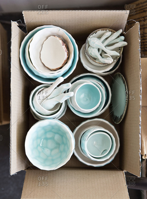 Box filled with bowls and mortar and pestles