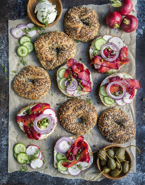 Overhead view of beet cured bagels and lox