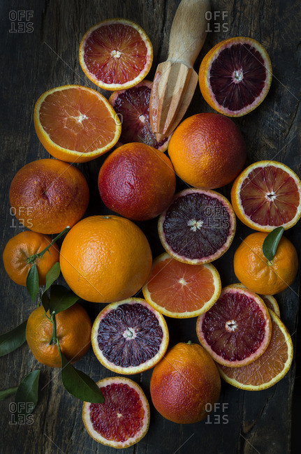 Variety of oranges on a wooden background