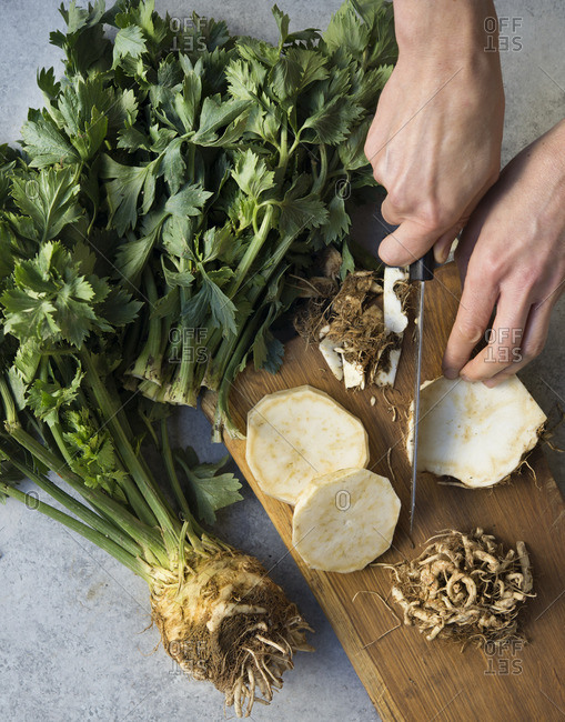 Person chopping celery root