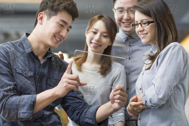 IT workers developing digital tablet
