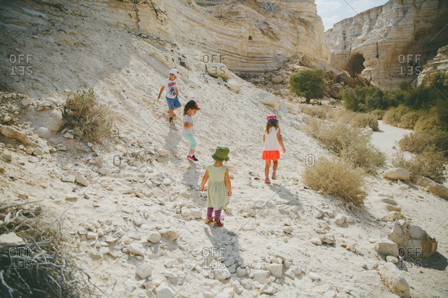 Children hiking in Ein Ovdat canyon