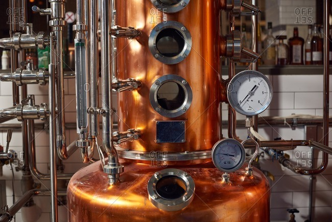 A copper distiller showing various pipes, for making whiskey, vodka and other high alcohol beverages.