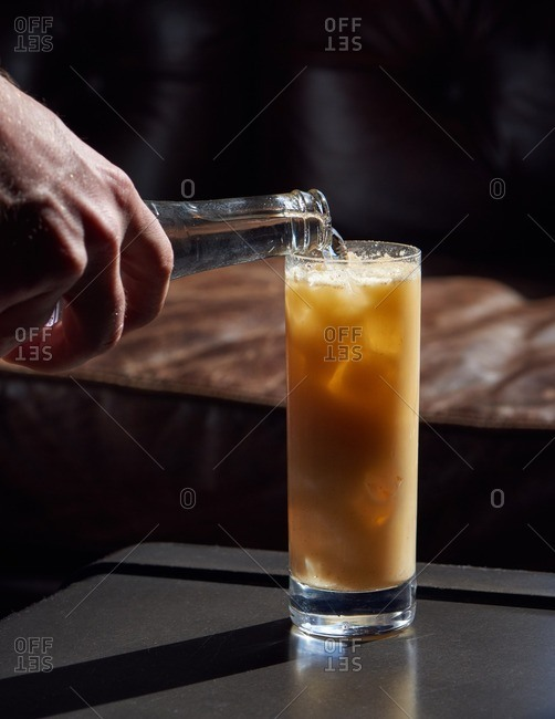 The Making of a Fizz drink with vodka, soda water and sour mix