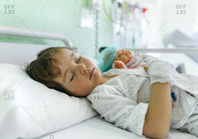 Little girl in a hospital bed