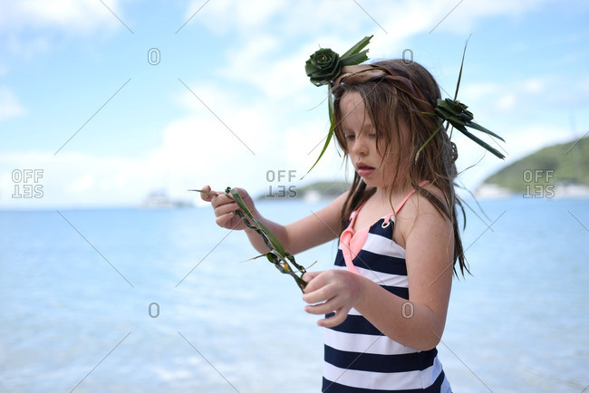 Little girl playing on beach