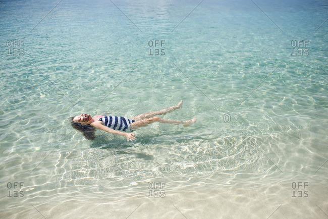 Girl doing back float