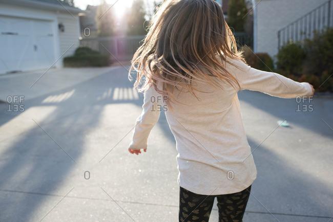 Girl twirling outside