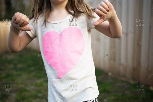 Girl pointing at shirt