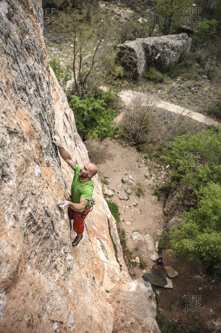 Man rock climbing on steepest limestone route
