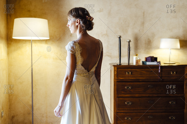 Bride posing in her hotel room just before her wedding in Salamanca, Spain