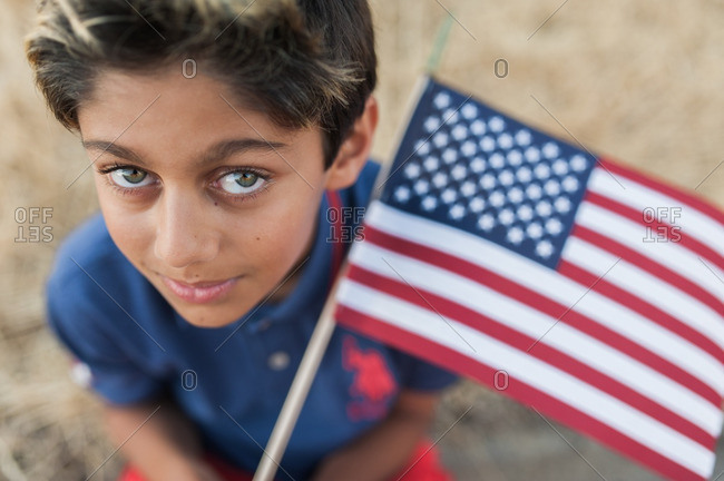 Close up of a young boy holding American flag