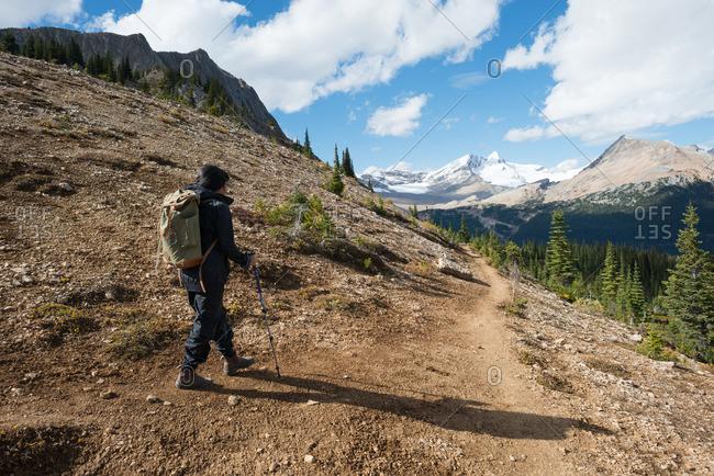 Female hiking along mountain ridge in the Rockies