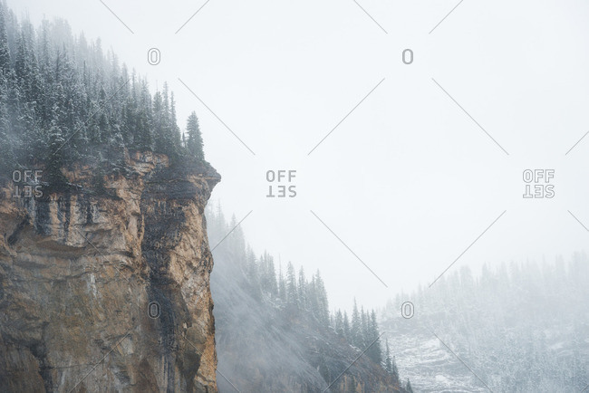 Cliff shrouded in white fog
