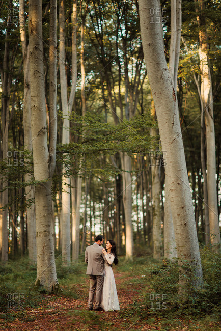 Bridal couple alone in forest