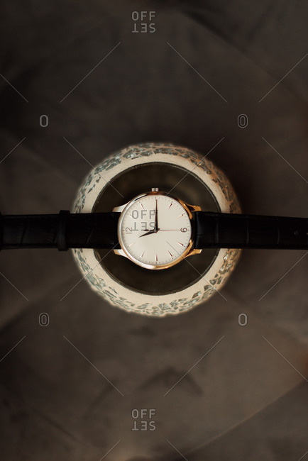 A wristwatch with black leather band