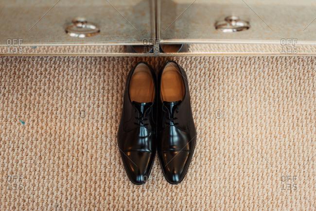 Men's dress shoes on carpet