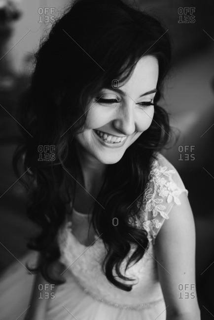 Smiling bride with long wavy hair