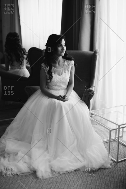 Bride in a chair smiling