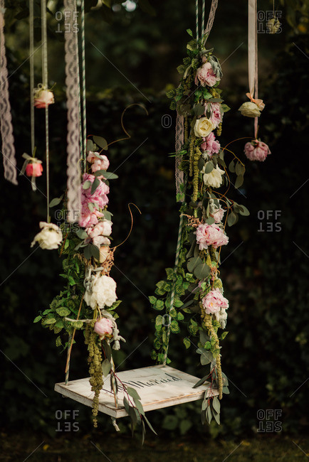 Swing decorated with roses for wedding