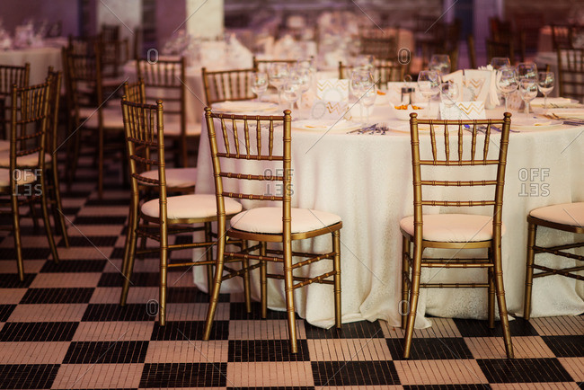 Chairs around wedding reception tables