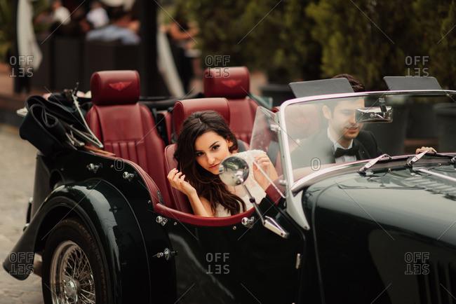Bride looking in car mirror