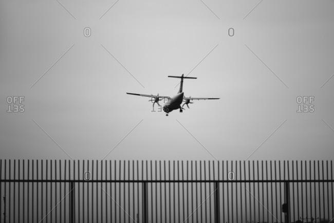 A plane coming into landing