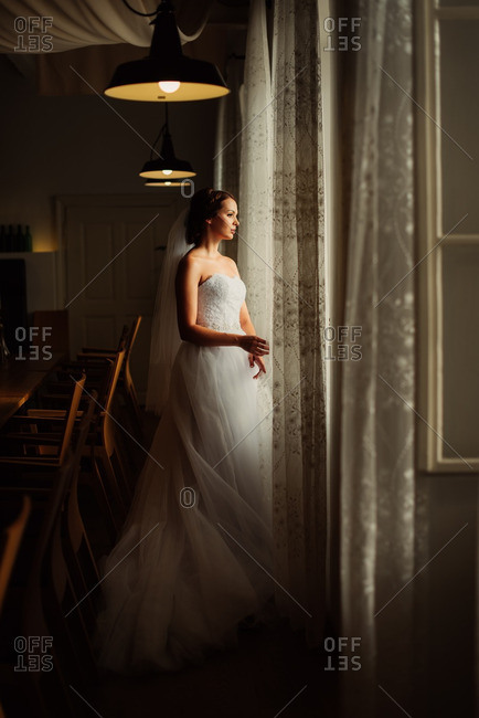 Beautiful bride looking out a window