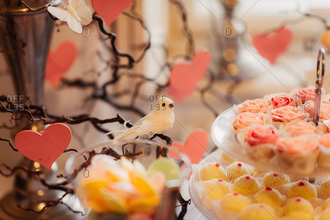 Bird decorations on a dessert table at a wedding