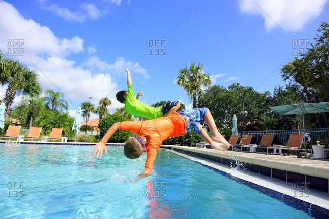 Two kids playing in swimming pool