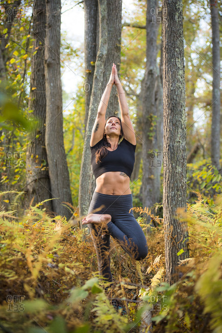 Woman practicing yoga in the forest